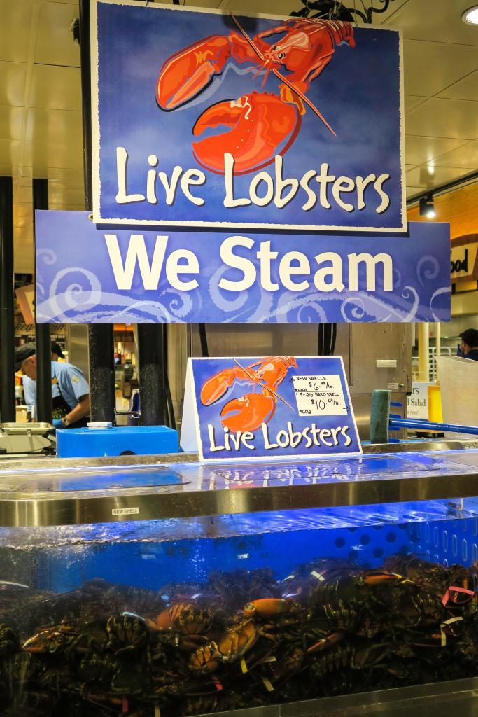 Live Lobster Tank, Seafood Section, Wegmans Grocery Store, Westwood, Massachusetts, USA. Image shot 2016. Exact date unknown.